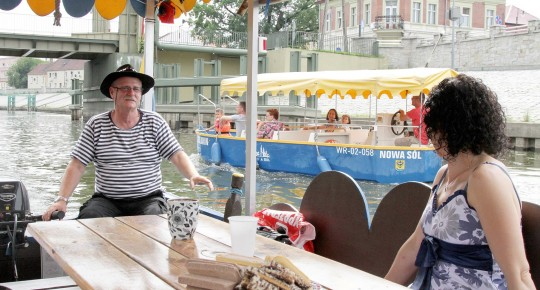 boat trip on the Oder: Woman and captain in boat