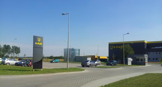 business in Uniejów - factory buildings, parking in front